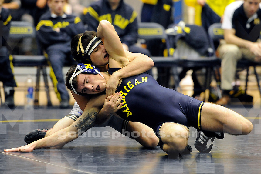 Michigan men's wrestling vs. Purdue at UM's Cliff Keen Arena, Friday, January 10, 2014.