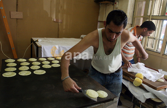 A Palestinian vendor prepares qatayef, a traditional pancake for Ramadan, at a shop in the West Bank city of Ramallah August 2, 2011. Muslims around the world abstain from eating, drinking and conducting sexual relations from sunrise to sunset during Ramadan, the holiest month in the Islamic calendar. Photo by Issam Rimawi