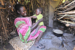 A woman and her daughter in a camp in rebel-held territory in the eastern Congo. Families displaced by fighting between rebel Tutsi General Laurent Nkunda and the Congolese military took refuge in this camp they established in the shadow of a United Nations base in the village of Kiwanja. According to aid workers and human rights groups, rebel soldiers executed some 150 people here in a 24-hour period in early November. The killings took place half a mile from the UN base, yet the 120 UN peacekeepers, part of the largest UN peacekeeping contingent in the world, did not take any action to stop the violence. ..
