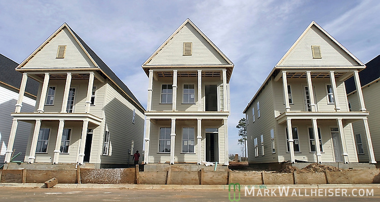 The narrow and tall homes, called Garden District House, are being constructed on Longfellow Rd. in the St Joe development Southwood Plantation in Tallahassee, Florida.