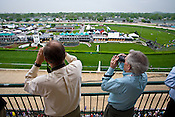 Horse race fans watch their bets on Oaks Day at Churchill Downs in Louisville, Kentucky, home of the Kentucky Derby.