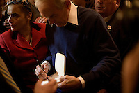 Congressman Ron Paul greets supporters after a town hall meeting and rally at the Church Landing at Mills Falls hotel in Meredith, New Hampshire, on Jan. 8, 2012. Paul is seeking the 2012 Republican presidential nomination.