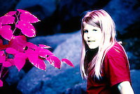 IMAGES MADE WITH INFRARED FILM<br /> Young Girl in Bright Yellow Shirt w/ Green Leaves<br /> Infrared film responds to the invisible, infrared portion of the spectrum in addition to visible light