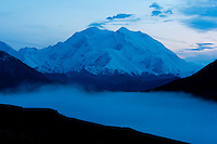 A fogbank rolls into foothills at the base of Mount McKinley in Denali National Park, Alaska.