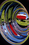 Classic Car show with classic car reflected in hub cap