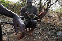 What makes this situation more difficult for all these tribes is that they are in the middle of an arms trade that goes across their porous borders between Sudan and Somalia.  Every grown man in these tribes owns AT LEAST an AK-47.  Some own ancient but HUGE POWERFUL belt fed machine guns like this Nyangatom man whose scars indicate how many Karos he has killed.