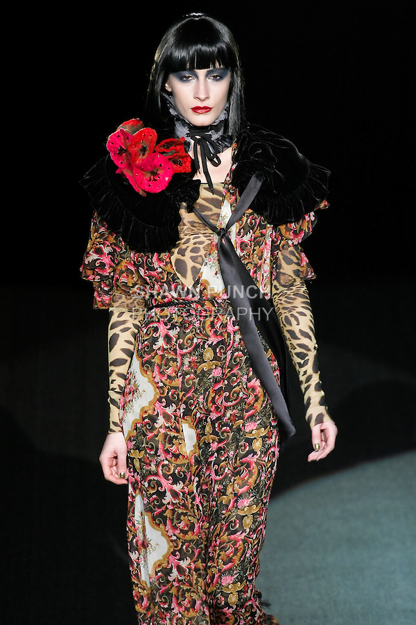 Yasmina walks runway in a Love Machine outfit, from the Betsey Johnson Fall 2011 He Loves Me Not - Black Tag collection, during Mercedes-Benz Fashion Week Fall 2011.
