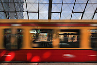 A moving train at the Berlin Hauptbahnhof, the main train station in Berlin, Berlin, Germany. Picture by Manuel Cohen