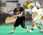 10 April 2011: University at Albany Great Dane defender Travis Lyons, a Junior from Farmingdale, NY, in action against the University of Vermont Catamounts on Moulton Winder Field in Burlington, Vermont. The Catamounts defeated the visiting Danes 11-6 in America East play. Mandatory Credit: Ed Wolfstein Photo