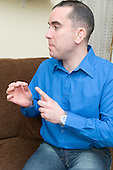 Man with a hearing impairment talking using sign language.  MR