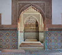 Hall of the three niches, Saadian tombs, Medina, Marrakech, Morocco. The tombs, near the Kasbah mosque, date from the reign of Sultan Ahmad al-Mansur, 1578-1603, and contain the mausoleums of members of the Saadi dynasty. The chamber or hall of the three niches contains the tombs of Saadi princes and their wives and concubines and is richly decorated with mosaics and stucco. Picture by Manuel Cohen