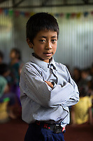 Aakash Tamang, 9, poses for a portrait in the SOS Children's Villages Child Care Space in Rayale, Nepal on 1 July 2015. Aakash Tamang's house had collapsed during the earthquake on 25th April 2015. Fortunately, all his family members are safe, but they are now displaced. Aakash has been very fond of the Child Care Space, where he enjoys learning, doing drama plays, and dancing with his friends. Photo by Suzanne Lee for SOS Children's Villages