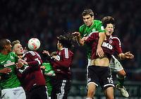FUSSBALL   1. BUNDESLIGA    SAISON 2012/2013    17. Spieltag   SV Werder Bremen - 1. FC Nuernberg                     16.12.2012 Theodor Gebre Selassie (li) und Sokratis Papastathopoulos (4.v.l., beide SV Werder Bremen) gegen Sebastian Polter,  Almong Cohen und Timm Klose (v.l., alle 1. FC Nuernberg)