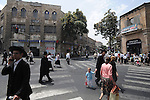 Ultra-Orthodox Jews cross a main junction close to Me'a She'arim neighborhood in Jerusalem.
