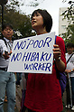 October 15, 2011, Tokyo, Japan - A protester displays a banner during speeches at Mikawadai park. Around 500 protesters took part in 3 separate protests in support of the Occupy Tokyo movement. The protesters airing a series of issues including Anti-Nuclear, Anti-Capitalism and Anti-TPP. They chanted '1% no thank you' and ' Nuclear no thank you ' at the rallies. Protesters in the Roppongi's Mikawadai Park numbered about 60 and were out numbered by around 70 Police and 40 members of the media. (Photo by Bruce Meyer-Kenny/AFLO) [3692]
