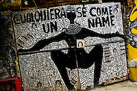 The Palo religious signs and symbols painted on the wall in Callejón de Hamel in Havana, Cuba, August 13, 2009. The Palo religion (Las Reglas de Congo) belongs to the group of syncretic religions which developed in Cuba amongst the black slaves, originally brought from Congo during the colonial period. Palo, having its roots in spiritual concepts of the indigenous people in Africa, worships the spirits and natural powers but can often give them faces and names known from the Christian dogma. Although there have been strong religious restrictions during the decades of the Cuban Revolution, the majority of Cubans still consult their problems with practitioners of some Afro Cuban religion.