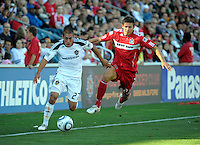 LA Galaxy forward Bryan Jordan (27) breaks free from Chicago defender Krzystof Krol (23).  The LA Galaxy tied the Chicago Fire 1-1 at Toyota Park in Bridgeview, IL on September 4, 2010