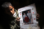 A Palestinian boy holds a picture of the Dhuheir three children, who were killed after a fire swept through their house in Gaza City on January 31, 2013. Hazem Dheir, his wife Sahar and their four young children were killed in the fire that is believed to have started by an electrical faul. Photo by Ashraf Amra