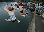 Kimberly LaVair, (L to R), Cassie Graves and Patty Thomas jump into the Burley Lagoon during the 24th annual Polar Bear Jump in Olalla, Washington on January 1, 2008. Jim Bryant Photo. ©2010. ALL RIGHTS RESERVED.