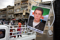 Pictures of those killed in the uprising hang in the newly renamed Liberty square in Zabadani, the only town in Syria officially held by the rebels. The hill town is surrounded by government forces.Protests against the ruling Baathist regime of Bashar al-Assad erupted in March 2011. Although they were initially peaceful,  they were violently repressed by the Syrian army and police. In response to being ordered to shoot unarmed civilians, large numbers of men deserted the army and formed the Free Syrian Army. The protest movement has now turned into an armed uprising with clashes between the regular army and the Free Syrian Army taking place in early 2012..