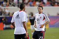David Beckham (23) of the MLS All-Stars talks with Thierry Henry (14) before the match. Manchester United defeated the MLS All-Stars 4-0 during the MLS ALL-Star game at Red Bull Arena in Harrison, NJ, on July 27, 2011.
