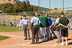 San Marin coach Mark Whitburn discusses the ground rules with the officials and the Acalanes High coaches before the NCS Division 3 final at San Marin High School on June 7, 2011. The officials suspended the game due to darkness after 10 innings. NCS officials declared both teams Co-champions.