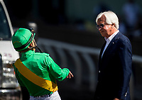 ARCADIA, CA - MARCH 11: Jockey, Mike Smith talks trainer Bob Baffert as he try to describe the injury sustained by Mastery in the San Felipe Stakes at Santa Anita Park on March 11, 2017 in Arcadia, California. (Photo by Alex Evers/Eclipse Sportswire/Getty Images)