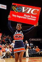 CHARLOTTESVILLE, VA- JANUARY 5: A Virginia Cavalier cheerleader holds a Harris Teeter vic card sign during the North Carolina Tar Heels game against the Virginia Cavaliers on January 5, 2012 at the John Paul Jones arena in Charlottesville, Virginia. North Carolina defeated Virginia 78-73. (Photo by Andrew Shurtleff/Getty Images) *** Local Caption ***
