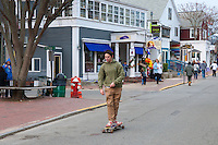 Teenager on skateboard in Provincetown, Cape Cod