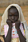A girl arrives at school in the morning in the Dereig Camp for internally displaced persons.
