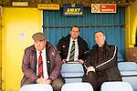 Canvey Island 1 Harrow Borough 0, 17/10/2015. The Frost Financial Stadium, Ryman Premier League. The away officials take their seats for the second half. Canvey Island in yellow play host to Harrow Borough in red in a Ryman Premier League match. The match was won by the home side by 1 goal to 0 and was watched by a crowd of 333. Canvey Island play at their home matches at The Frost Financial Stadium or Park Lane. The ground is a few feet below sea level, making it one of the only football stadiums in the UK to be as such. The ground has a capacity of over 4,500 and the stadium has reached its capacity on one occasion, when the team faced Northampton Town in the FA Cup in 2001. Photo by Simon Gill