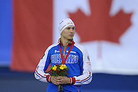 SPEEDSKATING: CALGARY: 15-11-2015, Olympic Oval, ISU World Cup, Podium 500m Men, winner Pavel Kulizhnikov (RUS), ©foto Martin de Jong