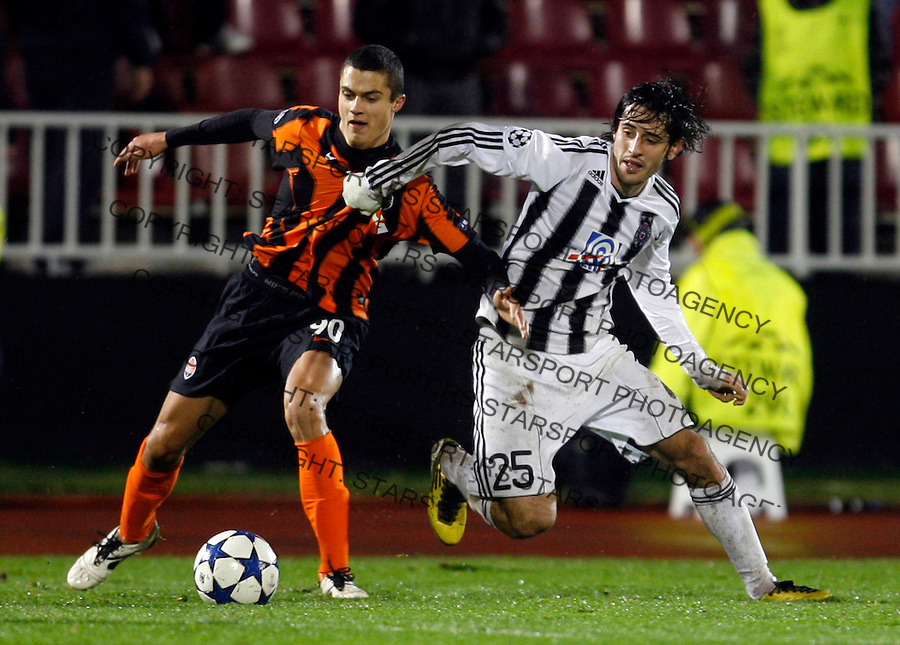 Vitaliy Vitsenets, Stefan Babovic, UEFA Champions League match, Group H, Partizan Belgrade vs Shakhtar Donetsk,  Belgrade, Serbia, Tuesday, 23. November 2010. (credit & photo: Pedja Milosavljevic / +381 64 1260 959 / thepedja@gmail.com)