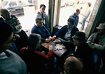 Groups of men watch others play dominos in a cafe in Praia on Terceira, Azores. Far out in the Atlantic Ocean, some 850 miles off the western coast of Lisbon, Portugal lies the 425-mile long archipelago of the Azores. (Jim Bryant Photo).....