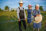 Mennonite children, brother and two sisters at farm in Shipyard, Belize