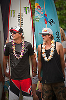 HALEIWA, HI (Thursday Dec. 3, 2009) Andy Irons (HAW) with brother Bruce Irons (HAW) .The opening ceremony of the Quiksilver in Memory of Eddie Aikau was held today at Waimea Bay. This year's event is the 25th Anniversary  and will be held on one day , between December 1, 2009 and February 28, 2010, when the waves eceed the  20 foot  minimum threshold and the 28 invitees will compete for the $98.000 prize purse...The northern hemisphere winter months on the North Shore signal a concentration of surfing activity with some of the best surfers in the world taking advantage of swells originating in the stormy Northern Pacific. Notable North Shore spots include Waimea Bay, Off The Wall, Backdoor, Log Cabins, Rockpiles and Sunset Beach... Ehukai Beach is more  commonly known as Pipeline and is the most notable surfing spot on the North Shore. It is considered a prime spot for competitions due to its close proximity to the beach, giving spectators, judges, and photographers a great view...The North Shore is considered to be one the surfing world's must see locations and every December hosts three competitions, which make up the Triple Crown of Surfing. The three men's competitions are the Reef Hawaiian Pro at Haleiwa, the O'Neill World Cup of Surfing at Sunset Beach, and the Billabong Pipeline Masters. The three women's competitions are the Reef Hawaiian Pro at Haleiwa, the Gidget Pro at Sunset Beach, and the Billabong Pro on the neighboring island of Maui...Photo: Joliphotos.com