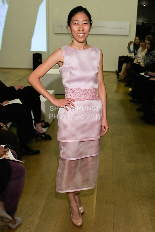85 Broads member walks runway in a SS12 Oxana tulip dress by Yuna Yang, during the 85 Broads Presents Yuna Yang trunk show at Art Gate Gallery on October 24th 2011.