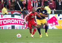 Toronto, Ontario - May 17, 2014: Toronto FC forward Jermain Defoe #18 battles for a ball with New York Red Bulls defender Jamison Olave #4 in the second half during a game between the New York Red Bulls and Toronto FC at BMO Field. Toronto FC won 2-0.