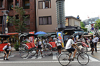 Rickshaw drivers, Asakusa, Tokyo, Japan, August 28, 2011. Sensoji is one of the oldest temples in Tokyo, and the shopping arcades around it have sold visitors souvenirs for centuries.