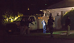 "TEANECK, NJ (Nov. 4, 2013) — New Jersey State Police scream ""Dorp it, drop it!"" as they take the father of Richard Shoop into custody at gunpoint at about 1 am after the elder Shoop emerged from his Teaneck home brandishing a screwdriver hours after his 20-year-old son opened fire at the nearby Garden State Plaza in Paramus."