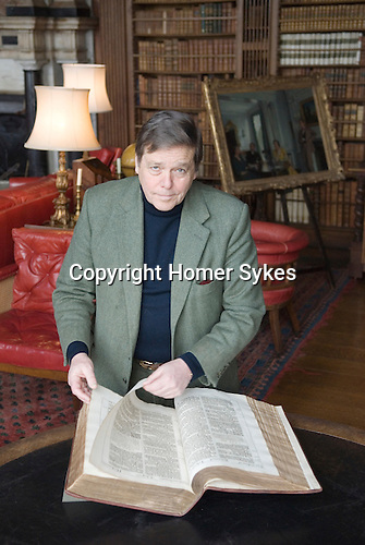 Robert Gascoyne-Cecil, Lord Salisbury at Hatfield House, Hatfield. Hertfordshire UK. Seen here with the King James Bible in the library.
