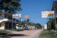Young tourists walking down the main street of Cahuita on the Caribbean coast of Costa Rica