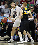 Gonzaga's Pryemek Karnowski (24) tries to move around Iowa's Aaron White (30) during the 2015 NCAA Division I Men's Basketball Championship's March 22, 2015 at the Key Arena in Seattle, Washington. #2 Gonzaga beat #7 Iowa 87-68 to advance to the Sweet 16.  ©2015 Jim Bryant Photo. ALL RIGHTS RESERVED.