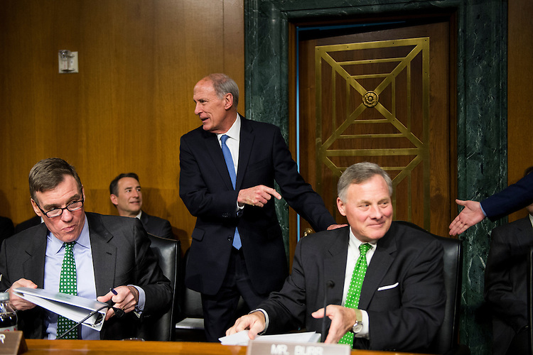 UNITED STATES - FEBRUARY 28: Vice chairman Sen. Mark Warner, D-Va., left, and chairman Sen. Richard Burr, R-N.C., right, greet former Sen. Dan Coats, R-Ind., nominee to be Director of National Intelligence, for his confirmation hearing in the Senate Select Committee on Intelligence on Tuesday, Feb. 28, 2017. (Photo By Bill Clark/CQ Roll Call)
