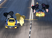 Feb 28, 2016; Chandler, AZ, USA; NHRA funny car driver Del Worsham (left) against Jim Campbell during the Carquest Nationals at Wild Horse Pass Motorsports Park. Mandatory Credit: Mark J. Rebilas-