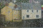 Rain drops on the window of a pub in Pembroke, Wales, the United Kingdom.
