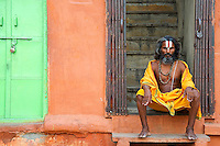 A Sadhu Holy man in Jaipur City, street scene and Market area also called the pink City Rajasthan India,