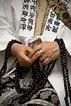 """Take Nakamura, 79, one of Japan's few remaining """"itako"""" (a kind of shaman) uses beads and bones to call on the spirits of a deceased relative of a client  in Hachinohe City, Aomori Prefecture Japan on 03 Sept. 2011. Photograph: Robert Gilhooly"""