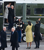 Washington, DC - January 20, 2009 -- United States President Barack Obama waves alongside First Lady Michelle Obama as former US President George W. Bush and Laura Bush wave from the presidential helicopter as they prepare to leave the US Capitol after Obama was sworn in as the 44th US president in Washington, DC, on January 20, 2009..Credit: Saul Loeb - Pool via CNP