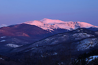 mount washington is draped in alpenglow at sunrise during the frigid month of february, White Mountains NH
